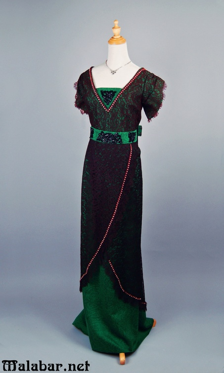 1910s evening female green black lace.jpg