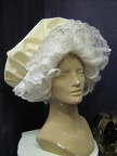 Mrs. Claus wig and large cap