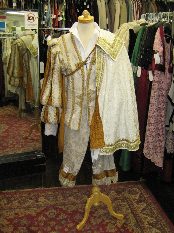 Cavalier man white & gold with cape.jpg
