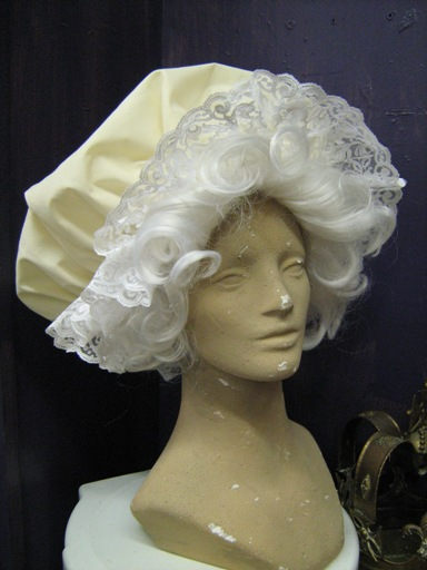 Mrs. Claus wig and large cap.jpg